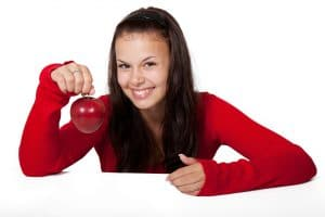Girl holding healthy apple